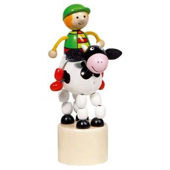 Motorické a didaktické hračky - Mačkací figurka – Jezdec na kravičce